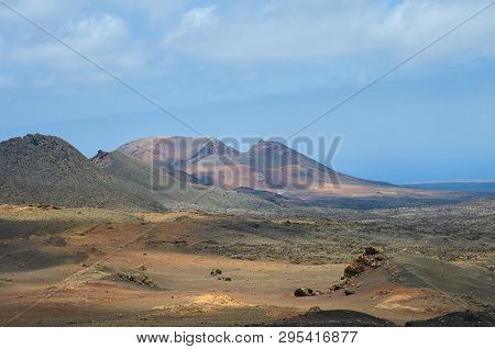 View Of Volcanic Crater In Valle Del Silencio, Valley Of Silence In Timanfaya National Park In Lanza