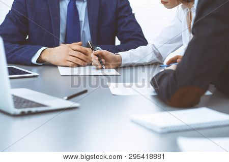 Group Of Business People And Lawyer Discussing Contract Papers Sitting At The Table, Closeup. Busine