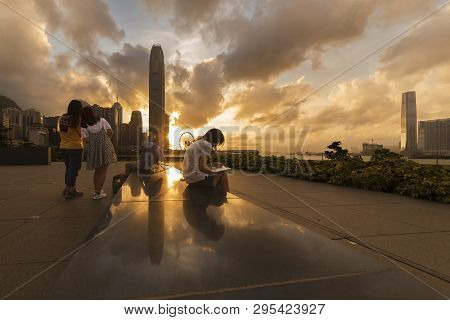 People Enjoying Sunset In Hong Kong City