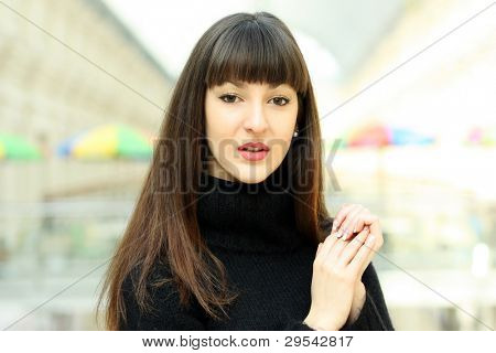 Young pretty woman standing  in GUM. Moscow, Russia