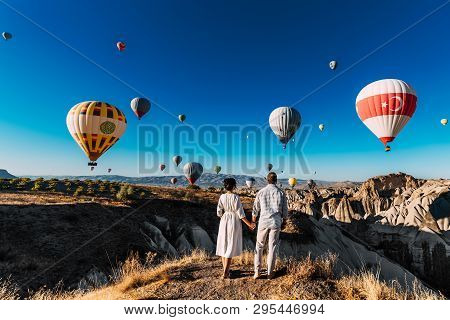 Wedding Travel. Honeymoon Trip. Couple In Love Among Balloons. A Guy Proposes To A Girl. Couple In L