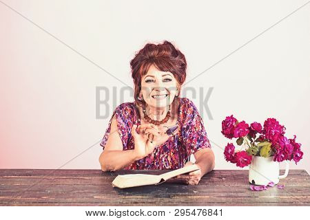 Pension And Retirement, Old Age. Old Woman Reading Book With Glasses At Flowers. Happy Old Lady Or G