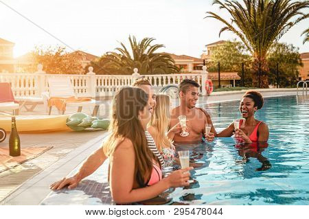 Group Of Happy Friends Making A Pool Party At Sunset - Millennial Young People Laughing And Having F
