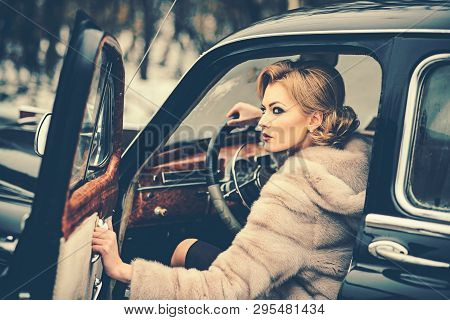 Sexy Woman In Fur Coat. Call Girl In Vintage Car. Travel And Business Trip Or Hitch Hiking. Retro Co