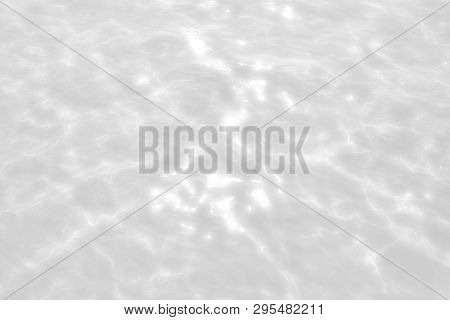 Rippled Water Texture Background. Wave Abstract Background In Light Gray Tonality