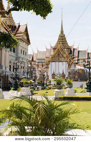 Bangkok, Thailand - March 2019: View Over Grand Palace And Chakri Maha Prasat Hall Through The Trees