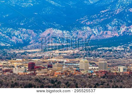 Colorado Springs, Colorado, USA downtown skyline and mountains at dusk.