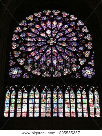 Paris, France - July 21, 2011: Rose Window Stained Glass Art Of Notre Dame Cathedral In Paris, Franc
