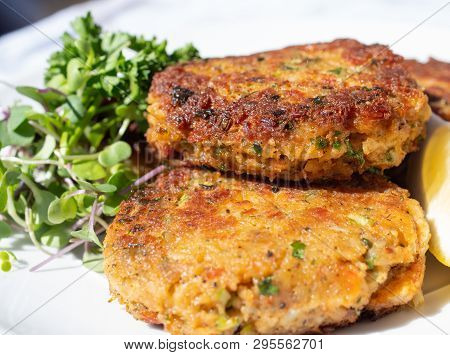 Savoury, Crisp And Starchy, Fishcakes, Crab Cakes..fried Fish Patties Served On A Plate With Salad O