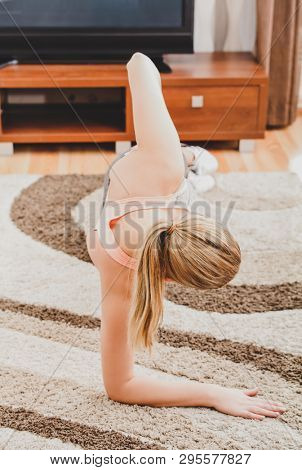 Woman is exercising on floor in home. Doing fitness workout.