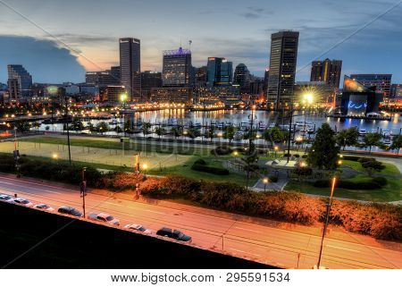 Baltimore, Md - August 13, 2018: View On Baltimore Skyline And Inner Harbor From Federal Hill At Sun