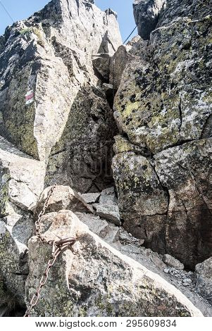 Difficult Hiking Trail Secured By Chain On Tri Kopy Peak On Rohace Mountain Group In Western Tatras