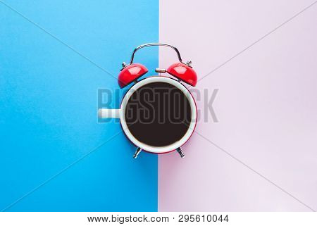 Morning Coffee Concept. Alarm Clock And A Cup Of Coffee All In One. Coffee On Blue Background