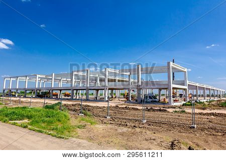 Landscape Transform Into Urban Area With Machinery, People Are Working On Unfinished Modern Edifice.