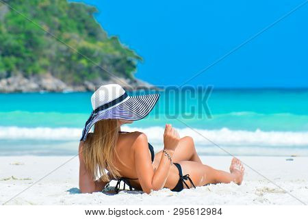 Sexy Woman In Bikini Enjoy Tropical Vacation. Girl In Hat Relaxing On Summer Holiday. Girl With Perf