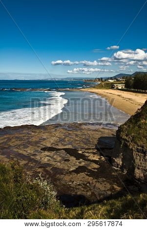 Beach At Clifton, Illawarra, Nsw Near Wollongong With Rocks In Foreground.