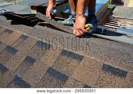 Repairing Of Roof By Cutting Felt Or Bitumen Shingles During Waterproofing Works.