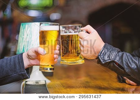 Friends Cheers Glasses. Friday Leisure Tradition. Beer Pub Concept. Beer Mug On Bar Counter Defocuse