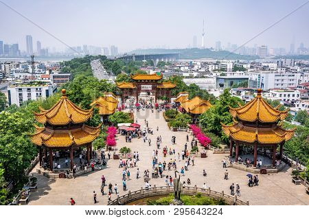 25 April 2018, Wuhan China : Scenic View Of The Yangtze Great Bridge With People And Crane Statue Fr