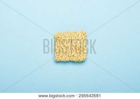 Chinese Instant Noodles On A Blue Background. The Concept Of Convenience Foods, Fast Food, Junk Food