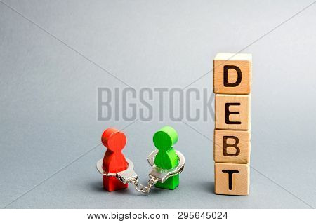 Two People Are Bound By Handcuffs With The Word Debt. Creditor And Debtor. Financial Slavery. Unclos