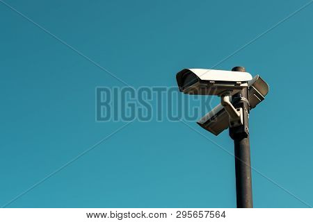 Security Cameras With Blue Sky As Background, Surveillance And Private Property Protection Technolog