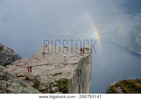 Preikestolen Pulpit Rock With Double Rainbow In The Background A Lysefjord Underneath