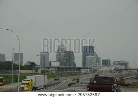 Louisville, Kentucky city skyline, cityscape of highrise office buildings as seen from a distance on highway Interstate 71 poster