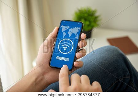 Man Hands Holding Phone With App Wifi Connect On The Screen In The House In Room