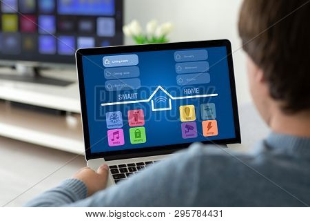 Man Holding Laptop With App Smart Home On The Screen In The House In The Room
