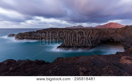 A Long Exposure Of The Sea At The Shore Of Lanzarote After The Sunset. This Part Of The Shore Is Cal