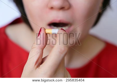 Woman takes a pill, girl putting capsule in mouth. Sick female taking medicines, painkiller, antibiotic or antiallergenic drug poster