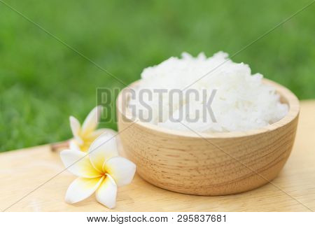 Close Up White Rice In Wooden Bowl With Green Nature Background, Healthy Food, Selective Focus