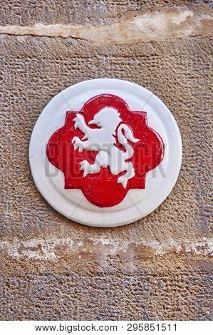 Antique Ubeda City Symbol. White Lion And Red Background. Spain