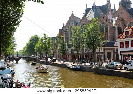 Amsterdam, Netherlands - June 6, 2018: Side View Of The Oldest Building And Oldest Parish Church In