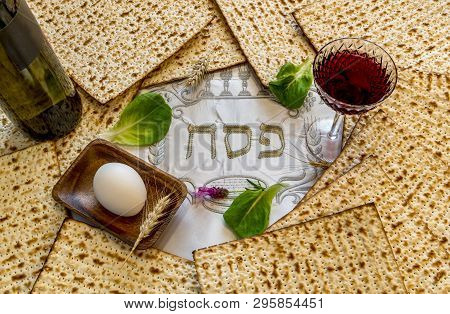 Unleavened Bread Food - Matzah And Glass Of Red Wine For Jewish Passover Holiday. Serviette With Wri