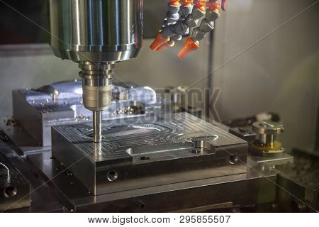 The  Operation Of Cnc Machining Center Cutting The Mold Parts .the Cnc Milling Machine Rough Cutting