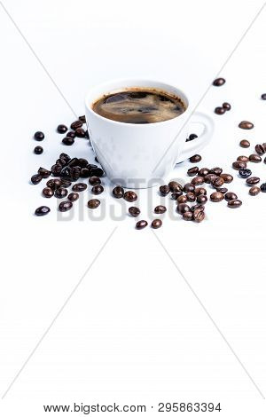 White Porcelain Cup Of Coffee With Roasted Coffee Beans Isolated On White Background