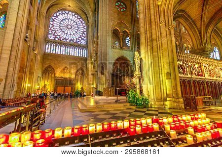 Paris, France - July 1, 2017: People Lighting The Candles In Central Nave Altar Of Notre Dame Of Par