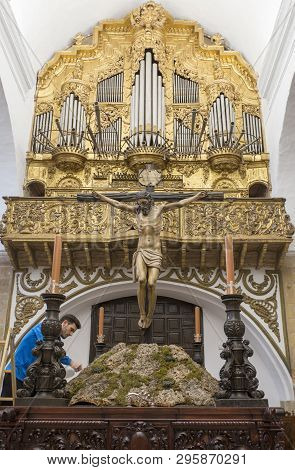 Jerez De Los Caballeros, Spain - April 15th, 2019: Brother Member Cleaning Preparing A Easter Throne