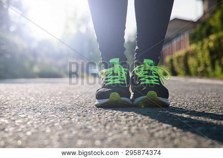 Runner Feet Running On Road,woman Fitness Sunrise Jog Workout Welness Concept