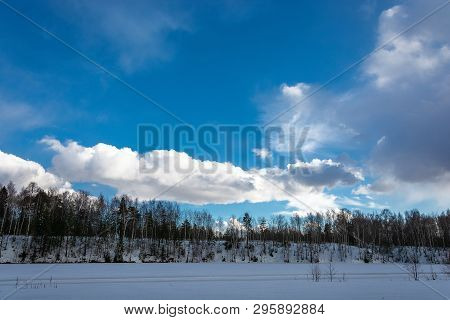 Beautiful Bright Clouds On The Blue March Sky In The Spring Day.