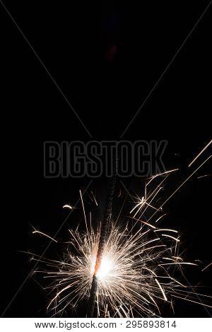 Bright Sparks Of Bengal Fire On A Black Background.