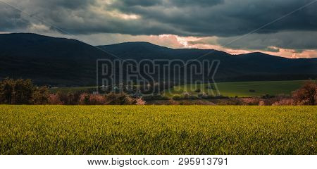 Panoramic Photo Of Povazsky Inovec Hill In Slovakia With Small Village In The Valley On Sunset. Land