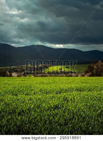 Povazsky Inovec Hill In Slovakia With Small Village In The Valley On Sunset. Landscape Photo Of Whea