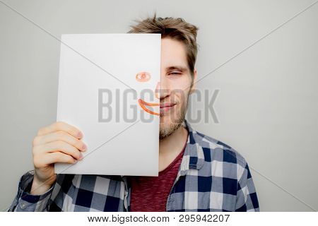 Portrait Of Attactive Man Hold Hand Drawn Emotion Half Face Mask