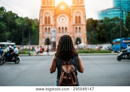 Young Woman Traveler Traveling Into Notre Dame Cathedral At Ho Chi Minh City In Vietnam