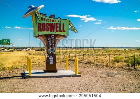 An Entrance Road Going To Roswell, New Mexico