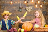 Held responsible for daily farm chores. Kids farmers girl boy vegetables harvest. Children presenting farm harvest wooden background. Family farm. Reasons why every child should experience farming poster