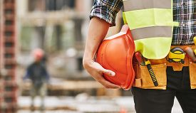 Construction Worker. Cropped Photo Of Male Professional Builder In Working Uniform With Construction